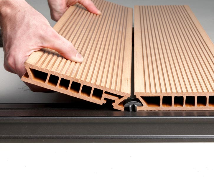 Products wood plastic composite manufacturer in tamil for Plastic composite decking