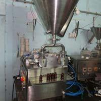 Twin Head Vacuum Liquid Filling Machine