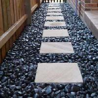 Astha Pebbles offers White Rough Pebbles White Pebbles Tiles from