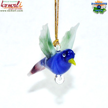 Colorful glass bird figurines