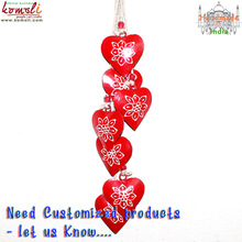 Wrought iron red heart-shaped hanging string
