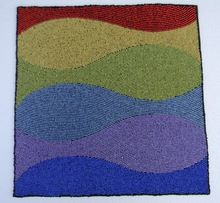 Waves embroided placemat
