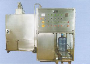 AUTOMATIC FILLER AND CROWNER
