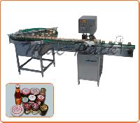 FULLY AUTOMATIC LUG CAPPING MACHINE.