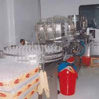 Automatic Volumetric Liquid Filling and Capping Machine