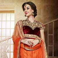 Orange Wedding Lehenga With Heavy Worked Maroon Choli