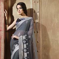 Radhika Fibers Black Color Brasso Saree With Designer Blause