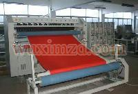Automatic ultrasonic quilting and cross cutting machine