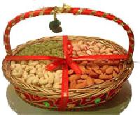 Mix dry fruits in cane basket arrangement