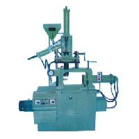 vertical plunger type plastic injection moulding machine