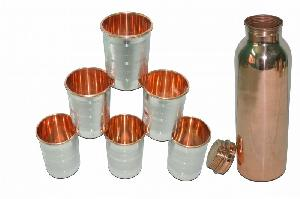 PURE COPPER BOTTLE WITH METAL GLASS.
