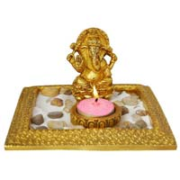 statue from manufacture a oil diya holder with Ganesh figure