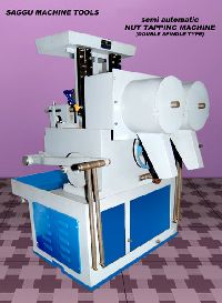 Nut tapping machines