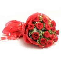 15 Red Roses In A Paper Packing
