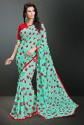 Shaily Gorgeous Turquoise Color Printed Georgette Saree