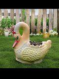 Designer swan plant pot