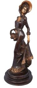 Lady with basket a handmade metal craft with antique finish
